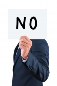 "Man holding a sign that says ""No"""