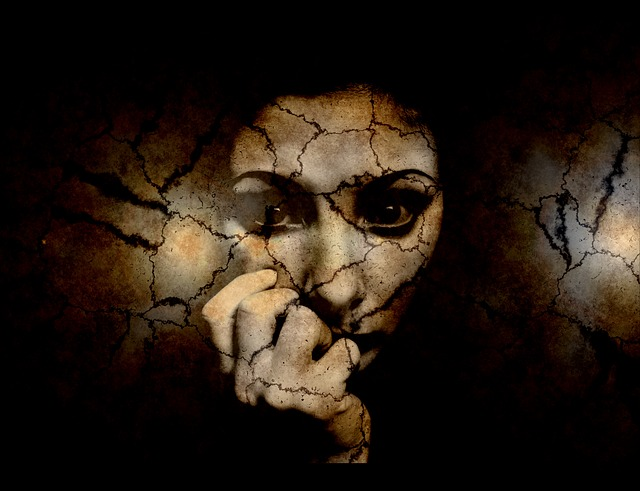 A woman appears fractured and fearful.