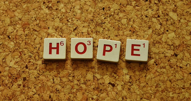Scrabble tiles spell out the word HOPE