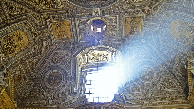 sunlight beams through a window of a church at the Vatican