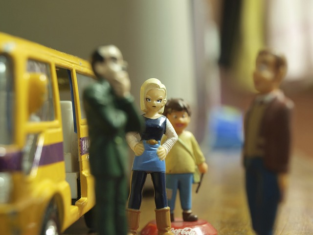 An image of a scene made with toys. A woman with her hands on her hips looks on, annoyed, at two men talking.