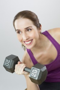 A woman lifting a 20-pound weight