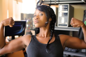 A woman flexing her arm muscles