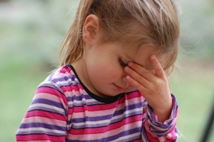 A little girl looking worried