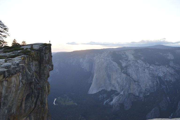 A hiker stands on a firm foundation, a mountain.
