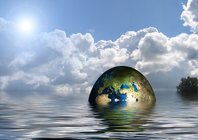An image of the world half submerged in water. Repairing the World.