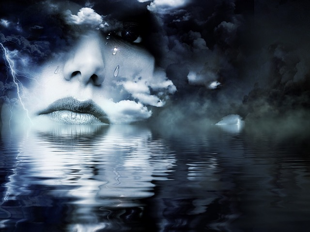 A woman's face appears amidst clouds.