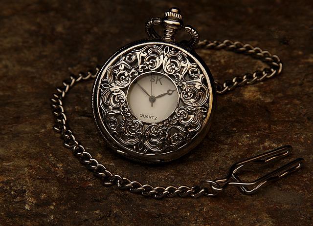 A beautiful silver pocket watch.