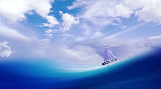 a sailboat on a wave