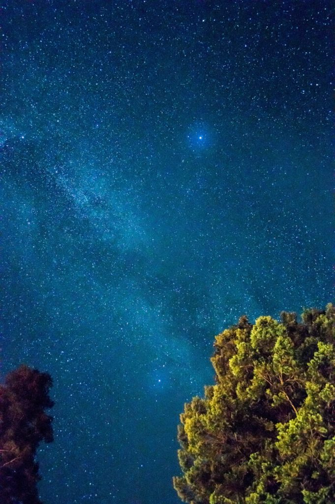 a blue night sky with one bright star