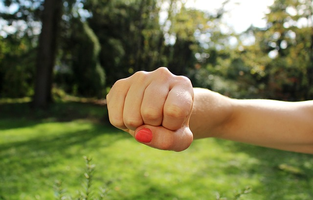 A woman's fist is shown , heading towards the viewer