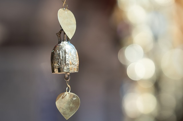 An image of a delicate hanging silver bell.
