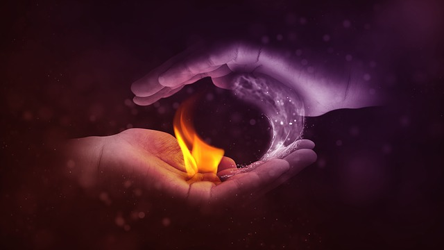 An image of two hands cupping a small flame.